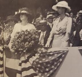 With the Democratic presidential candidate's wife Margareta Cox, Eleanor Roosevelt reviews a 1920 campaign parade. (International News Photo)