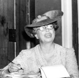 Eleanor Roosevelt signing some typed correspondence. (floridamemory.com)