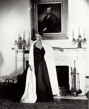 Eleanor Roosevelt as First Lady, standing before a portrait of her paternal grandfather, a family role model for his social welfare work. (Corbis)