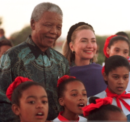 Hillary Clinton with South Africa's Nelson Mandela and young girls of that nation, 1997. (Getty)