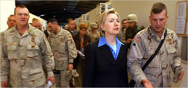 Senator Clinton making a 2003 visit to troops in Iraq. (New York Times)