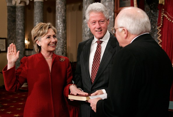 Bill Clinton holds the Bible on which Hillary Clinton took the oath for her second term as Senator. Less than three weeks later, she filed to declare her candidacy for the presidency in 2008. (Getty)