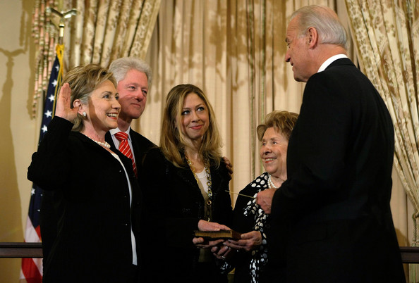 Hillary Clinton was sworn in as Secretary of State with her husband, daughter and mother holding the Bible as recently-inaugurated Vice President Joseph Biden swore her in. (Getty)