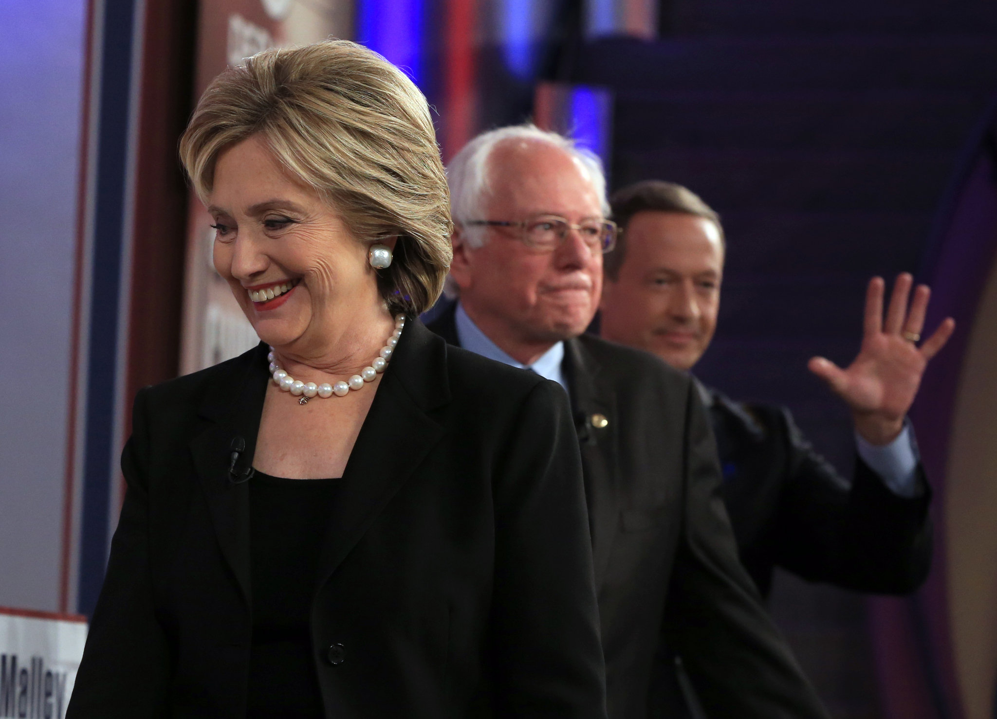 Hillary Clinton leaving a debate stage with rivals for the 2016 Democratic presidential convention, U.S. Senator Bernie Sanders and former Maryland governor Martin O'Malley. (nola.com)